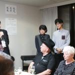 肥塚肇雄氏(写真左)スピーチ